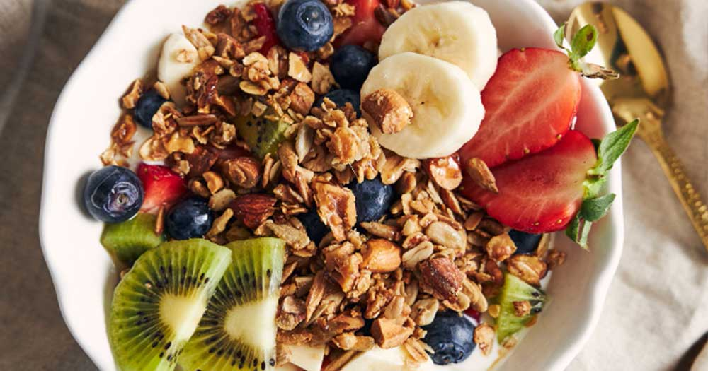 eating healthy granola snacks and fruits for fitness
